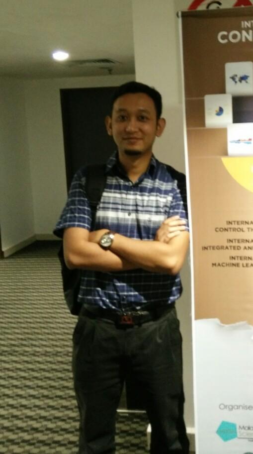 Dr Hariz attending conference