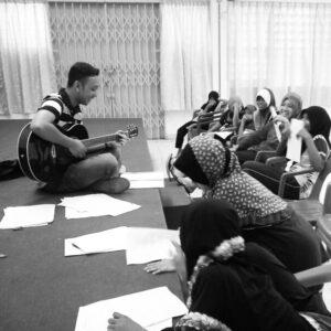 Dr Hariz teaching orphans